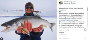 AmeriCorps Member with Fish