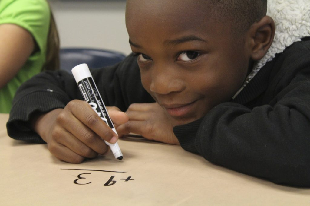 Boy doing math problem