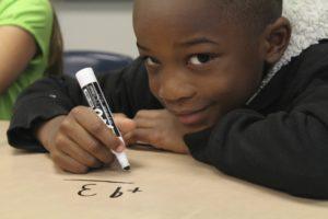 Boy doing math problem