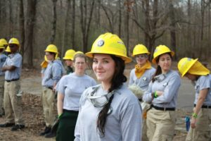 Conservation Corps members in the woods