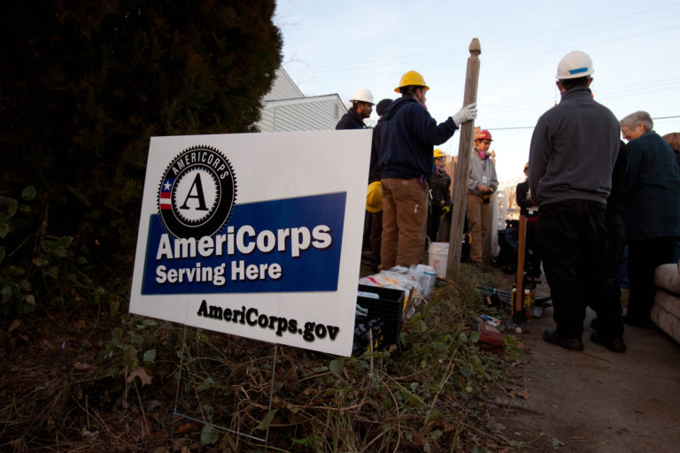 AmeriCorps Serving Here sign