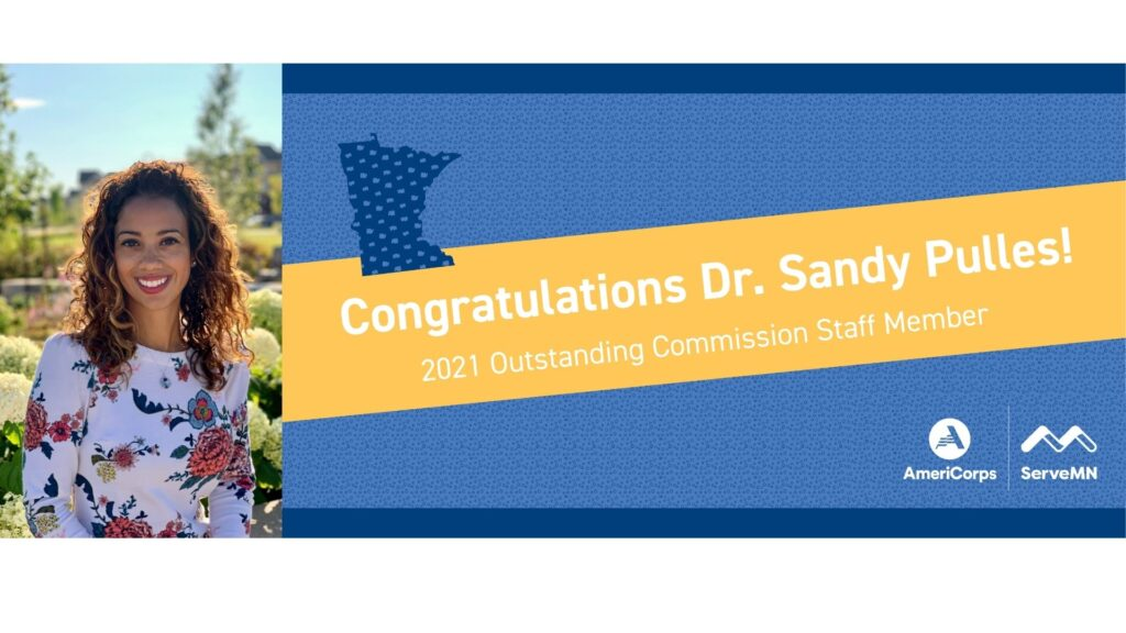 Congratulations Dr. Pulles in white on a yellow banner
